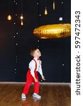 little boy in white shirt  red... | Shutterstock . vector #597472343