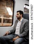 man listening music from his... | Shutterstock . vector #597473987