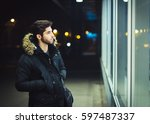 young man walking at night and... | Shutterstock . vector #597487337