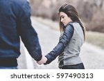 young couple holding hands  ... | Shutterstock . vector #597490313
