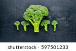 fresh broccoli on dark wooden... | Shutterstock . vector #597501233