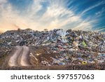 garbage pile in trash dump or... | Shutterstock . vector #597557063