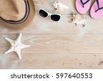 straw hat and sunglasses on wood   Shutterstock . vector #597640553