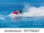 man on jet ski jump on the wave ...   Shutterstock . vector #597748367