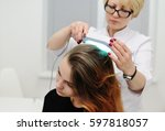 doctor examines scalp a pretty... | Shutterstock . vector #597818057