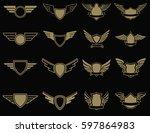 Set Of Winged Emblems In Golde...