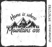 home is where the mountains are.... | Shutterstock .eps vector #597872783