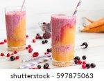 rainbow smoothies  orange and...   Shutterstock . vector #597875063