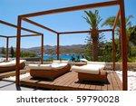 modern hut and sunbeds at... | Shutterstock . vector #59790028