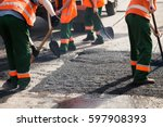 workers on asphalting paver... | Shutterstock . vector #597908393