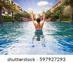 woman raising both hands in... | Shutterstock . vector #597927293