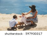 happy family playing with a cat ... | Shutterstock . vector #597930317