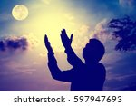 man praying  | Shutterstock . vector #597947693