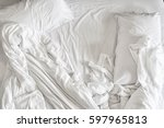 top view of unmade bedding... | Shutterstock . vector #597965813