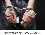 Man In Handcuffs With Money.