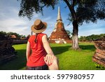 tourist woman in red shirt... | Shutterstock . vector #597980957