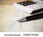 a pen with calculator over... | Shutterstock . vector #598079483
