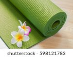 yoga mat with flowers | Shutterstock . vector #598121783