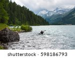 canoeist alone in the lake of... | Shutterstock . vector #598186793