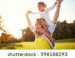 happy mother with daughter... | Shutterstock . vector #598188293