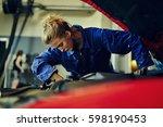female mechanic fixing a red... | Shutterstock . vector #598190453