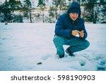 caught fish on ice fishing   Shutterstock . vector #598190903