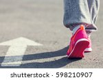 athletic pair of feet on a grass | Shutterstock . vector #598210907