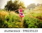 happy little girl running on... | Shutterstock . vector #598235123