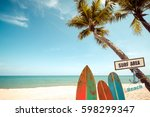 vintage surf board with palm... | Shutterstock . vector #598299347