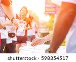 runner take a water in a... | Shutterstock . vector #598354517