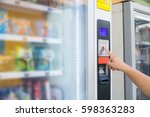 female hand push button to make ... | Shutterstock . vector #598363283