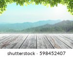 wood table top on mountain... | Shutterstock . vector #598452407