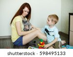 a child with her mother is... | Shutterstock . vector #598495133