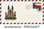 an envelope with a postage... | Shutterstock .eps vector #598526327