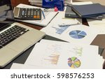 desk office and graph analysis... | Shutterstock . vector #598576253
