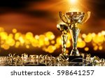 champion golden trophy on wood... | Shutterstock . vector #598641257