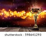 champion golden trophy on wood... | Shutterstock . vector #598641293