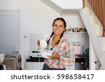 young beautiful woman cooking... | Shutterstock . vector #598658417