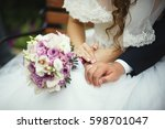 hands of the newlyweds and... | Shutterstock . vector #598701047