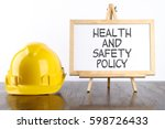 safety helmet and white board... | Shutterstock . vector #598726433