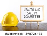 safety helmet and white board... | Shutterstock . vector #598726493