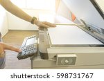 man copying paper from... | Shutterstock . vector #598731767