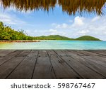 wood terrace on the sea beach... | Shutterstock . vector #598767467