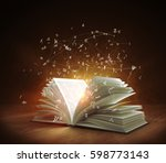 open magic book with magic... | Shutterstock . vector #598773143