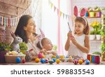 a mother and her daughter are... | Shutterstock . vector #598835543