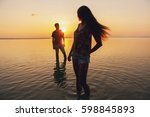 young beautiful couple in love... | Shutterstock . vector #598845893