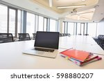 laptop and files on empty... | Shutterstock . vector #598880207