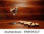 Wine Glass And Wine Corks On...