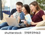 three excited friends buying a... | Shutterstock . vector #598939463