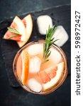 grapefruit and rosemary gin... | Shutterstock . vector #598972427